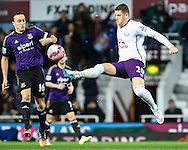 Mark Noble of West Ham United is beaten to the ball by Ross Barkley of Everton during the FA Cup match at the Boleyn Ground, London<br /> Picture by David Horn/Focus Images Ltd +44 7545 970036<br /> 13/01/2015