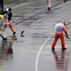 F1 Australian Grand Prix 16 March 2013 Qualifying Session 1.Qualifying Session 1. Safety staff work to remove some of the water off the track during qualifying..(c) MILOS LEKOVIC | StockPix.eu