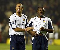 Photo: Chris Ratcliffe.<br />Arsenal v West Ham. Barclays Premiership. 01/02/2006.<br />West Ham's Anton Ferdinand (L) and Nigel Reo-Coker celebrate at the end.