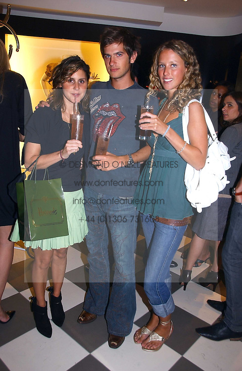 Left to right, NIKKI PENNIE, JACK FREUD and KATE MELHUISH at a party to celebrate the opening of PPQ Mayfair at 47 Conduit Street, London W1 on 18th September 2006.<br /><br />NON EXCLUSIVE - WORLD RIGHTS