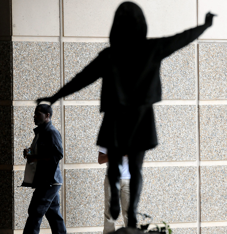 A sculpture called &quot;Balancing&quot; in the entrance to Yale-New Haven Hospital's Children's Hospital seems to be touching the head of a passerby.  Mara Lavitt/New Haven Register<br /> <br /> 10/15/12
