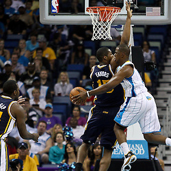 April 11, 2011; New Orleans, LA, USA; New Orleans Hornets point guard Chris Paul (3) passes off to center Aaron Gray (34) as Utah Jazz power forward Derrick Favors (15) defends during the first half at the New Orleans Arena.  Mandatory Credit: Derick E. Hingle
