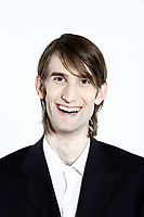 studio shot portrait of a young funny happy expressive thin and tall man on isolated background