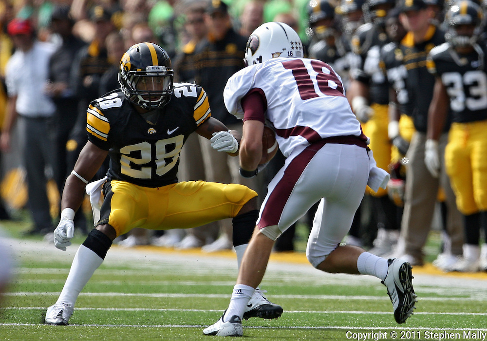 September 24, 2011: Louisiana Monroe Warhawks wide receiver Brent Leonard (18) tries to avoid Iowa Hawkeyes defensive back Shaun Prater (28) after a catch during the first quarter of the game between the Iowa Hawkeyes and the Louisiana Monroe Warhawks at Kinnick Stadium in Iowa City, Iowa on Saturday, September 24, 2011. Iowa defeated Louisiana Monroe 45-17.