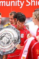 CARDIFF, WALES - SUNDAY, AUGUST 13th, 2006: Liverpool's Mark Gonzalez holds the  Community Shield after beating Chelsea 2-1 at the Millennium Stadium. (Pic by David Rawcliffe/Propaganda)