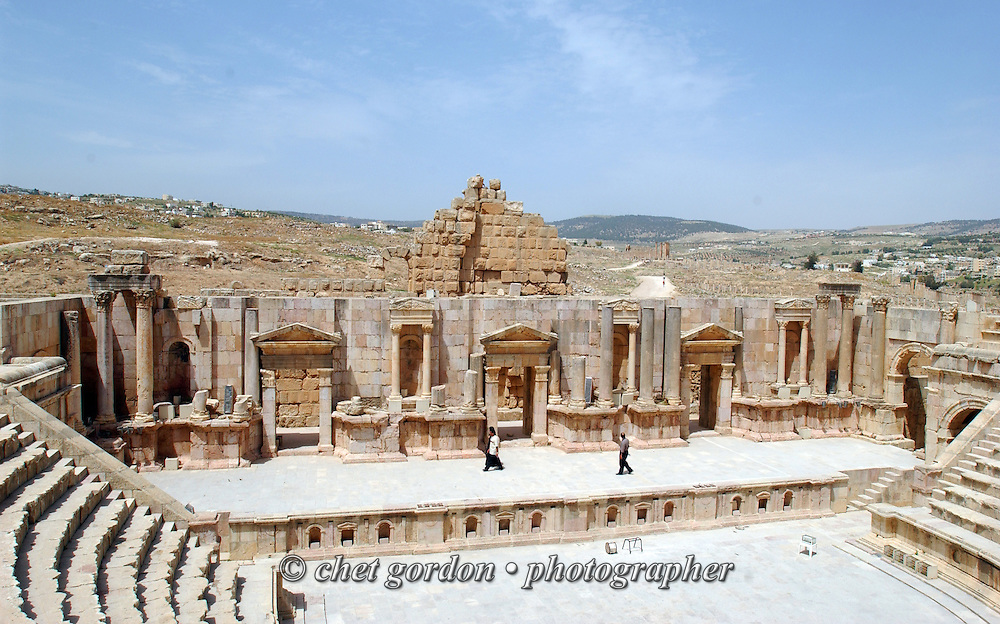 Jordanian tourists on the stage of an amphitheater in the ancient Roman city of Jerash on the outskirts of Amman, Jordan on Thursday, April 20, 2006.