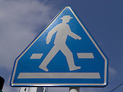 traffic sign with a walking figure indicating a pedestrian crossing Japan