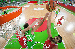 Matej Krusic of Slovenia between Luka Zoric of Croatia and Krunoslav Simon of Croatia during basketball match between National teams of Slovenia and Croatia in day 2 of Adecco cup, on August 4, 2012 in Arena Stozice, Ljubljana, Slovenia. (Photo by Vid Ponikvar / Sportida.com)