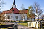 Tresfjord kirke er en åttekantet kirke fra 1828 på Sylte i Vestnes kommune, Møre og Romsdal fylke. Den er en del av Den norske kirke og hører til Indre Romsdal prosti i Møre bispedømme. Den har form som en avlang åttekant med sakristi og våpenhus. Den bærer preg av empirestil i interiøret. Det nåværende kirkebygget ble påbegynt i 1825, og kirken innviet 17. juni 1828. Bønder som leverte tømmer ervervet parter i kirken, og mye arbeid ble gjort på dugnad. Erik Kroken ledet byggearbeidet. Den fikk teglsteinstak og ble hvitmalt både innvendig og utvendig. Dekorasjonene innvendig ble laget av svensken Levin, med hjelp fra rosemaleren Martiuns Størheim. Kirken er bygget i tømmer og har 270 plasser. Lappesteinstaket er fra 1925 og kirken ble restaurert i 1927–29 ved Domenico Erdmann. <br /> Den har vært opprettingsprosjekt siden 1978, og har blitt støttet opp med wirer. I 2006–07 gjennomgikk kirken omfattende reparasjoner. Grunnmuren er fornyet, samt at kirken har blitt rettet opp og er nå som den var som ny. Den står nå selv, uten støtte fra wirer. I 2003 ble kirken besøkt av det norske kongeparet. Tresfjord kirke er en liten kirke med gamle fine dekorasjoner og inventar. Alterfrontalet er fra middelalderen med malte fremstillinger av jomfru Maria. Scener fra Jesu barndom henger over prekestolen. Motivet på altertavla er visstnok også å finne i en noe mindre utgave i Kölnerdomen i Köln i Tyskland. <br /> Antemensalet over prekestolen er fra første halvdel av 1300-tallet. Det er utført i olje, er 92 cm høyt og 135 cm langt. Det er ett av omkring 30 norske som har overlevd fra middelalderen til i dag, med unntak av dette og ett til er de andre på museum. Antemensalet er laget av furubord og sprekkene mellom bordene er dekket av pergament med oldnorsk skrift noe som viser at det er laget i Norge. Et gammelt teppe vevd av ull og lin er trolig et antependium og oppbevares på Norsk folkemuseum. Antemensalet ble trolig laget i Bergen. Erdmann skriver
