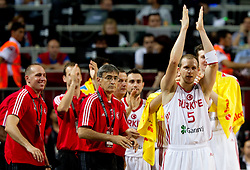 Head coach  of Turkey Bogdan Tanjevic and Sinan Guler of Turkey during  the eight-final basketball match between National teams of Turkey and France at 2010 FIBA World Championships on September 5, 2010 at the Sinan Erdem Dome in Istanbul, Turkey. (Photo By Vid Ponikvar / Sportida.com)