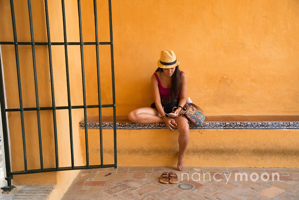 Granada, Spain young girl relaxes.<br />