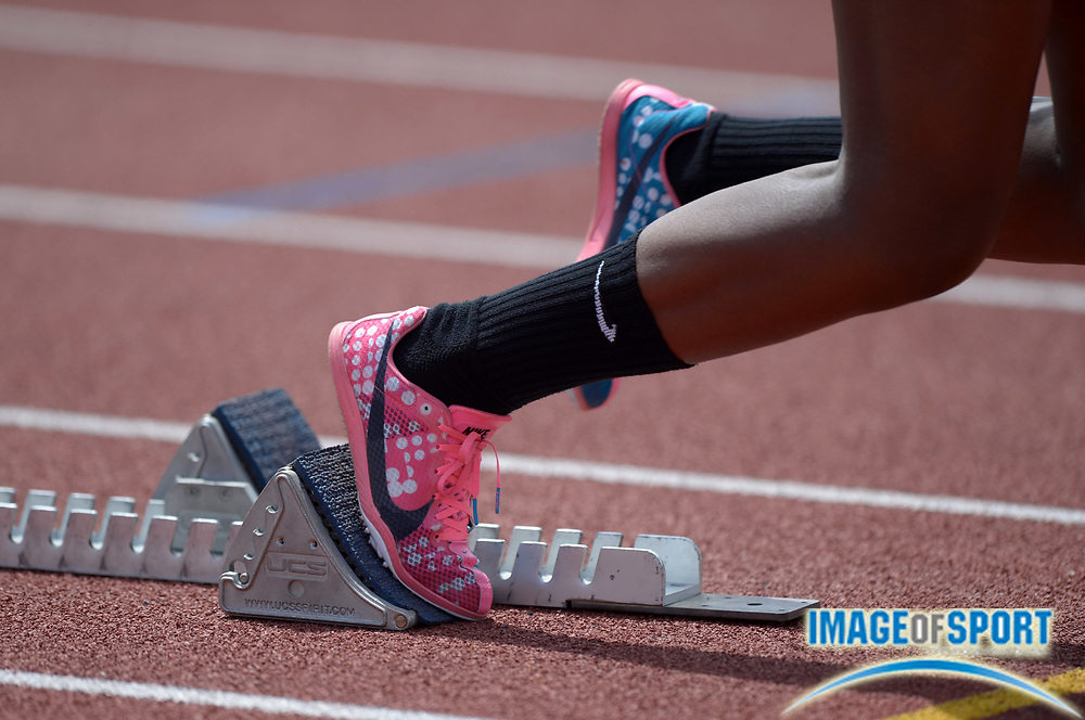 Mar 29, 2014; Austin, TX, USA; General view of the Nike spikes of Autumn Wright of Long Beach Poly in the starting blocks of the girls 4 x 200m relay in the 87th Clyde Littlefield Texas Relays at Mike A. Myers Stadium.