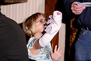 "An audience member helps out during Mayhem & Mystery's production of ""Tragedy in the Theater"" at the Spaghetti Warehouse in downtown Dayton, Monday, February 28, 2011."