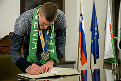 Blaz Blagotinsek signing the City of Ljubljana's Golden Book during reception of Slovenian National Handball Men team after they placed third at IHF World Handball Championship France 2017, on January 30, 2017 in City hall, Ljubljana centre, Slovenia. Photo by Vid Ponikvar / Sportida