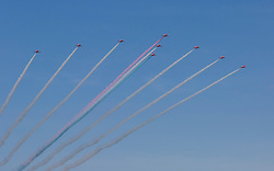 To celebrate the 100th anniversary of Edinburgh Airport, the famous Red Arrows Aerobatic Display Team fly over the aiport runway.