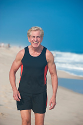 mature man walking on the beach