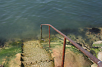 Steps with rusty handrail into the sea at Sandycove, County Dublin, Ireland