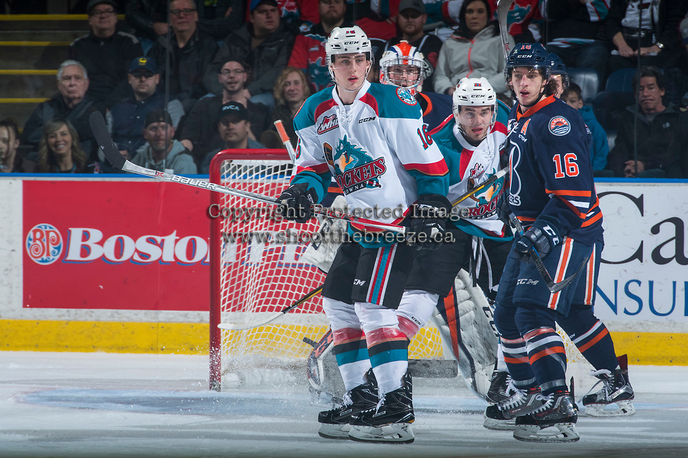 KELOWNA, CANADA - MARCH 31: Kole Lind #16 of the Kelowna Rockets looks for the pass ahead of Nick Chyzowski #16 of the Kamloops Blazers on March 31, 2017 at Prospera Place in Kelowna, British Columbia, Canada.  (Photo by Marissa Baecker/Shoot the Breeze)  *** Local Caption ***