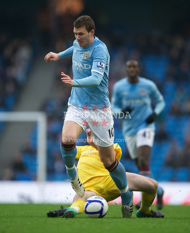 MANCHESTER, ENGLAND - Sunday, February 20, 2011: Manchester City's Edin Dzeko and Notts County's Ricky Ravenhill during the FA Cup 4th Round Replay match at the City of Manchester Stadium. (Photo by David Rawcliffe/Propaganda)