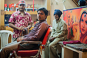 Men at barber shop in India