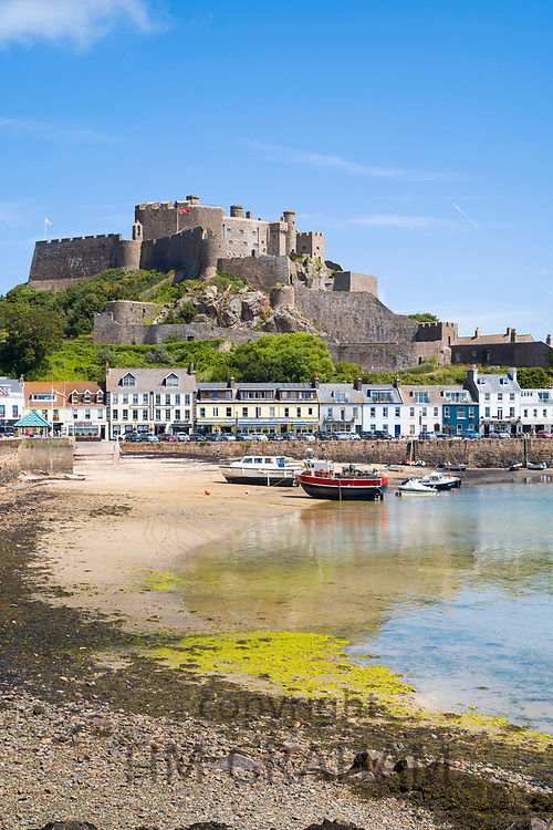 Mount Orgueil Castle overlooking the harbour and bay at low tide at Gorey on the east coast of Jersey, Channel Isles