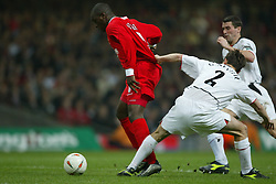 CARDIFF, WALES - Sunday, March 2, 2003: Liverpool's Emile Heskey has his shirt pulled by Manchester United's Gary Neville during the Football League Cup Final at the Millennium Stadium. (Pic by David Rawcliffe/Propaganda)