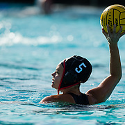 11 February 2018: The San Diego State  women's water polo team competes in day two of the Triton Invitation on the campus of UCSD. San Diego State Aztecs  driver Maddy Parenteau (5) looks to pass the ball during the third quarter. The Aztecs took on the #23 CSUN Matadors Sunday morning and came away with a 7-5 win.<br /> More game action at www.sdsuaztecphotos.com