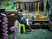 23 FEBRUARY 2018 - BANGKOK, THAILAND: A man sells hair extensions in Pratunam Market. Pratunam Market was one of the largest clothing markets in Bangkok. New airconditioned markets, like Platinum and Palladium malls opened nearby, siphoning away customers. Now there are only a handful of merchants left in the market and Bangkok city officials have plans to shut the market and redevelop the land.     PHOTO BY JACK KURTZ