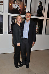 Photographer JOANNA VESTEY and her husband STEVEN BROOKS at a private view of photographs by Joanna Vestey entitled 'Dreams For My Daughter' in aid of The White Ribbon Alliance, held at The Royal Festival Hall, South Bank, London on 8th March 2012.