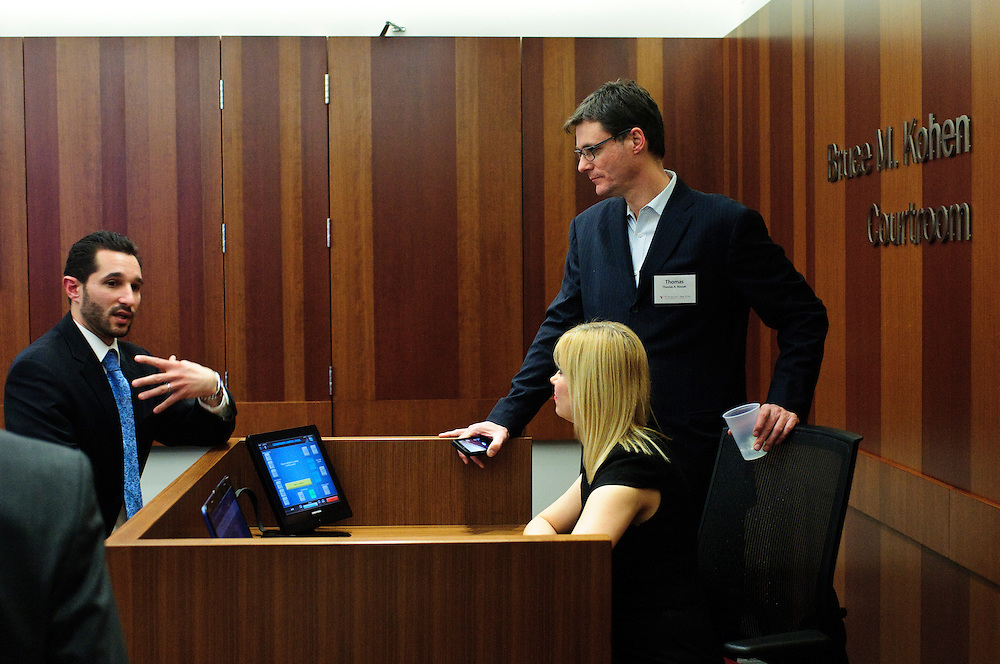 Chicago-Kent College of Law Adjunct Professor and Attorney Nicholas A. Caputo (left) chats with architect Thomas Roszak and wife Justyna on Thursday, January 24th following a demonstration of the technologically advanced Bruce M. Kohen Courtroom designed by Roszak. The classroom and competition venue features dual 90 inch screens with audio/visual and lighting controls. © 2013 Brian J. Morowczynski ViaPhotos