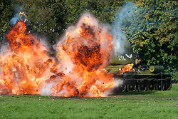 Pickering Showground War Time Weekend The Soviet 13th Guards T34 tank spectacularly knocked out with help of the Pyrotechnics team<br /> 11/12 October 2014<br /> Image © Paul David Drabble <br /> www.pauldaviddrabble.co.uk