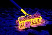 A glowing rake gathers a pile of money.Black light