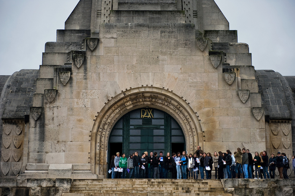 A school visiting the Douaumont ossuary (L'ossuaire de Douaumont) built in 1932 is a memorial containing the remains of soldiers who died at the battle of Verdun (21 February 1916 – 19 December 1916) During the battle 230.000 man died.  Ossuaire de Verdun, Verdun, Meuse, France