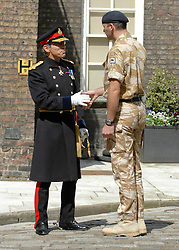 © under license to London News Pictures. 08/01/2011. General Cima pictured L), the Governor of The Tower of London has been removed from his position following a disciplinary investigation. No explanation has been given. Maj Gen Cima was appointed in 2006. PICTURED ON 21/05/2010 General Cima addresses the crowd at an historic medal presentation at the Tower of London. It is the first presentation of its kind ever to be held there. 150 mainly Royal Signals Officers and Soldiers who have just returned from Afghanistan were presented their Afghan Medals by General Cima, the Governor of The Tower of London. Picture credit should read Stephen Simpson/London News Pictures