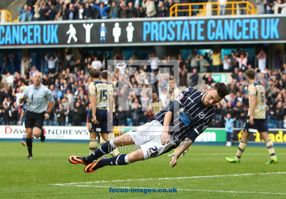 Picture by John Rainford/Focus Images Ltd +44 7506 538356<br /> 28/09/2013<br /> Scott Malone of Millwall celebrates scoring against Leeds United during the Sky Bet Championship match at The Den, London.