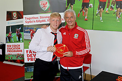 NEWPORT, WALES - Sunday, May 28, 2017: Cameron Keetch receives a cap from Elite Performance Director Ian Rush for participation during day three of the Football Association of Wales' National Coaches Conference 2017 at Dragon Park. (Pic by Mark Roberts/Propaganda)