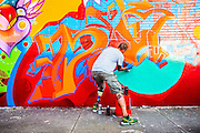Artist with prosthetic leg spray-paints mural in Miami's Wynwood arts distruct