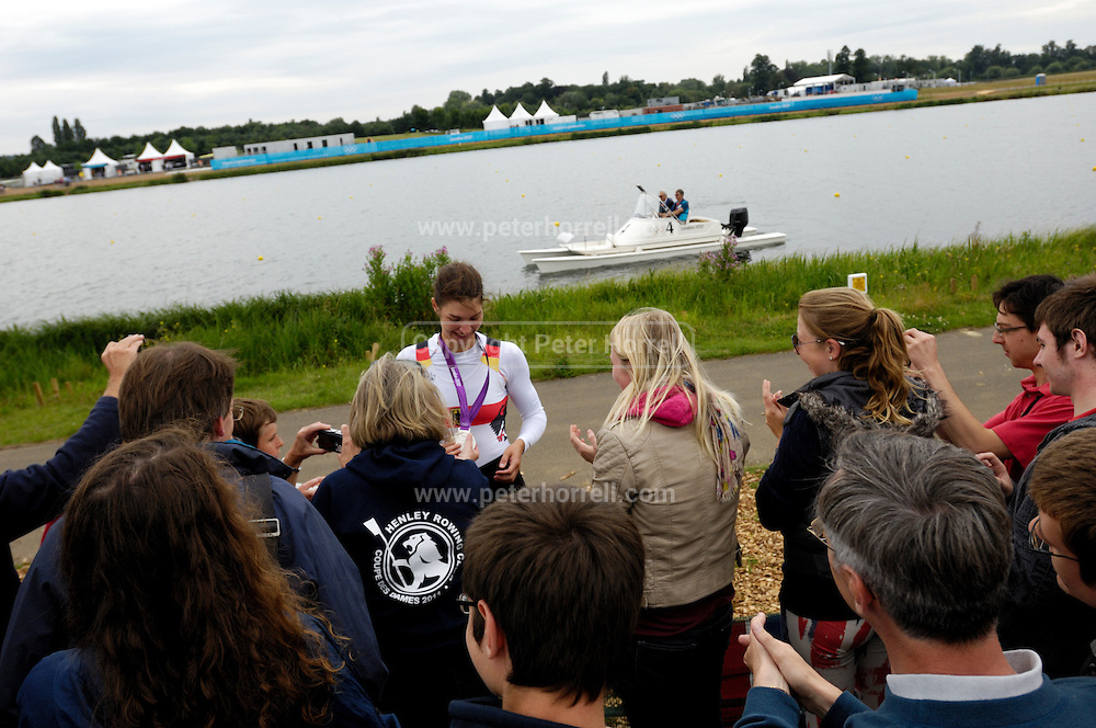 UK, August 1 2012: Women's Quadruple Sculls rower, Carina Baer,  shows off her Women's Quadruple Sculls Olympic silver medal at Eton Dorney.  Copyright 2012 Peter Horrell.