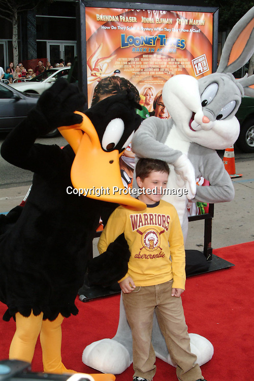 Josh Hutcherson with Daffy Duck and Bugs Bunny<br />&ldquo;Looney Tunes:  Back In Action&rdquo; Film Premiere<br />Grauman's Chinese Theater<br />Hollywood, CA, USA<br />Sunday, November, 09, 2003 <br />Photo By Celebrityvibe.com/Photovibe.com