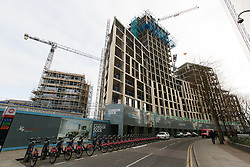 © Licensed to London News Pictures. 17/02/2016. London, UK. Construction work at the main London Dock site seen from Vaughan Way. London Dock is a residential mixed-use development on the 15 acre site of the former News International (now News UK) which has been fully demolished except for the listed Pennington Street warehouse and Times House, which is being refurbished . When fully completed, 486 of the 1,800 new homes will be affordable, with 274 affordable and social rented homes and 212 homes for first time buyers. Photo credit : Vickie Flores/LNP