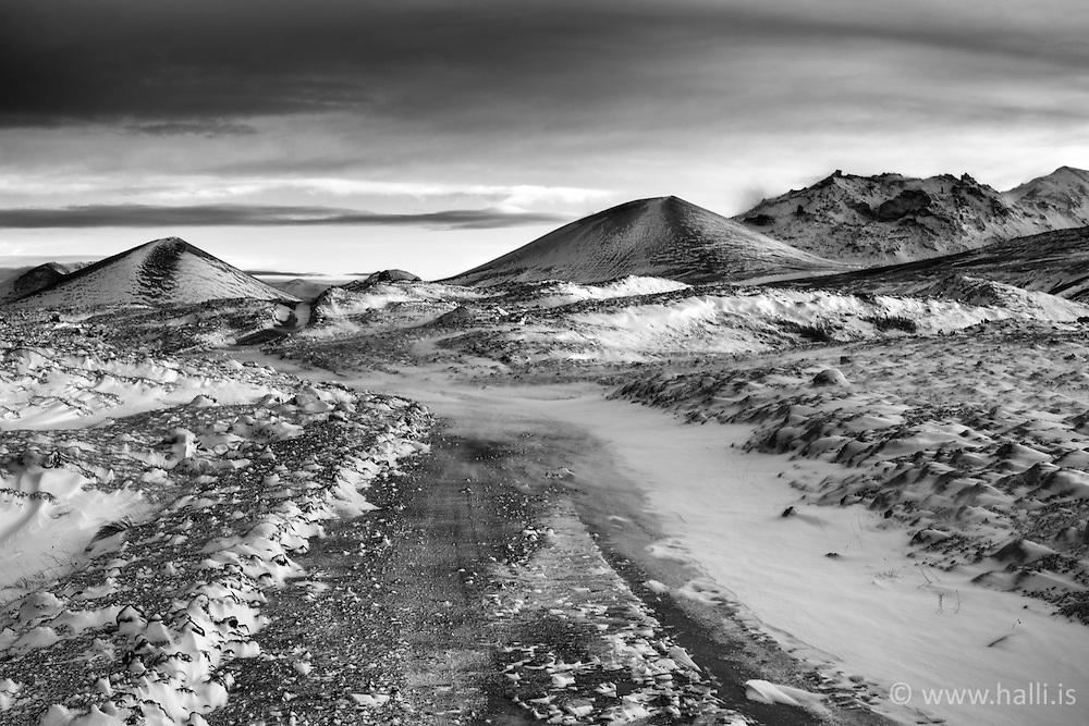 Snow covered lava and road in Berserkjahraun, Snaefellsnes, Iceland - Snævi þakið hraun og vegur í Berserkjahrauni á Snæfellsnesi