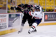October 13, 2007 - Anchorage, Alaska: Ryan Adams (42) of the Wayne State Warriors beats Kyle Burton (9) of the Robert Morris Colonials to the puck in the 1-4 loss to Robert Morris at the Nye Frontier Classic at the Sullivan Arena.