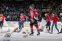 KELOWNA, CANADA - DECEMBER 6: Damon Severson #7 and Rourke Chartier #14 of the Kelowna Rockets  gather teddy bears after the first goal set off the annual teddy bear toss against the Everett Silvertips on December 6, 2013 at Prospera Place in Kelowna, British Columbia, Canada.   (Photo by Marissa Baecker/Shoot the Breeze)  ***  Local Caption  ***