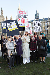 © Licensed to London News Pictures. 16/1/2014. London, UK. Stars from the cast of hit musical 'Made in Dagenham': Gemma Arterton, Isla Blair, Sophie Louise Dann, Sophie Stanton, Sophie Isaacs joined Gloria De Piero, Shadow Minister for Women and Equalities, Jane Bruton, Editor in Chief of Grazia and women from the original Dagenham equal pay strike: Gwen Davis, Sheila Douglass, Vera Sime attend an equal pay photocall outside parliament in Westminster, London on 16th December 2014. The implementation on Section 78 of the Equality Act is being debated in Parliament today. Photo credit : Vickie Flores/LNP