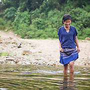 "INDIVIDUAL(S) PHOTOGRAPHED: Cao Thị Oanh. LOCATION: Cáo Village, Lâm Hóa Commune, Tuyên Hóa District, Quảng Bình Province, Vietnam. STORY: Life has dealt Oanh a tough hand. She's only 17, but due to her mother's illness, her family's survival depends on her and her husband. In the 1990s, the local government relocated her Ma Lieng community from their productive, arable land to their current location. Sitting in their cramped, one-roomed house, Oanh explains how she used to walk 3 km uphill each day, before illegally entering state-owned land to collect bamboo. It was a risky business for an unreliable income. Her neighbours in the village of Cao in Quang Binh Province faced similar struggles. Now, Oanh is more optimistic about what life has in store for her. Thanks to the efforts of Lam, the village leader who received training and support from the Centre for Indigenous Research and Development (CIRD), the community was returned its land use rights for the 200-hectare area on which it used to live. Oxfam worked with CIRD to better understand the issues faced by the community, and access to land was identified as a key priority (albeit one that would be extremely challenging to tackle). CIRD supported the community in advocating for land redistribution and made sure its members' voices were heard by the right people. The role of Lam, who spoke at events and negotiated on behalf of the Ma Lieng, was pivotal. Villagers were also trained in land use and management, and the importance of forest protection. A further five smaller communities were also given access to 1,000 hectares between them. Oanh now grows nuts on the shared land, which she will sell. ""CIRD have helped us gain good land and grow crops"", she says. ""Mrs Lam insisted that the government should support us with land rights, and it worked""."