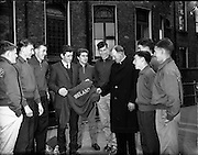 25/07/1962<br /> 07/25/1962<br /> 25 July 1962<br /> Catholic Students Games athletes at C.U.S., Lower Leeson Street, Dublin to receive briefing before travelling to the games in Brussels. Picture shows Team Manager, Fr K. Connolly, C.C., presenting track suits to a group of Munster students. Included (l-r): J. Moriarty of Listowel, Co. Kerry (Gormanstown, Co. Meath); D. Martin (Glenstal); Ian Hamilton, Cobh, Co. Cork (P.B.C. Cobh); M. Crowe of Killaloe (Gormanstown); V. O'Callaghan of Bantry (De La Salle, Waterford); B. Egan, (Glenstal); N. (H. ?) Fleischmann of Cork (Glenstal); S. O'Sullivan of Cork (Nth. Mon) and N. McSweenry of Cork (Nth. Mon).