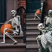Halloween skeleton decoration on side of brownstone in Greenwich Village, NYC.