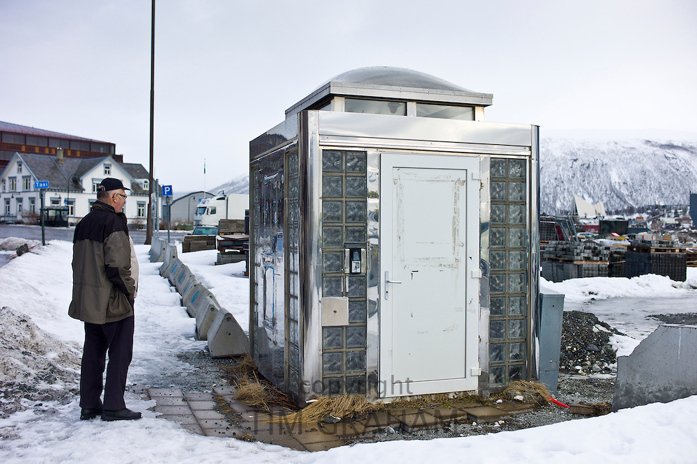 Man gazes at futuristic design Public Convenience toilet in Tromso, Norway
