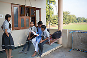 Shantilal with his children outside their home, Madhya Pradesh, India.