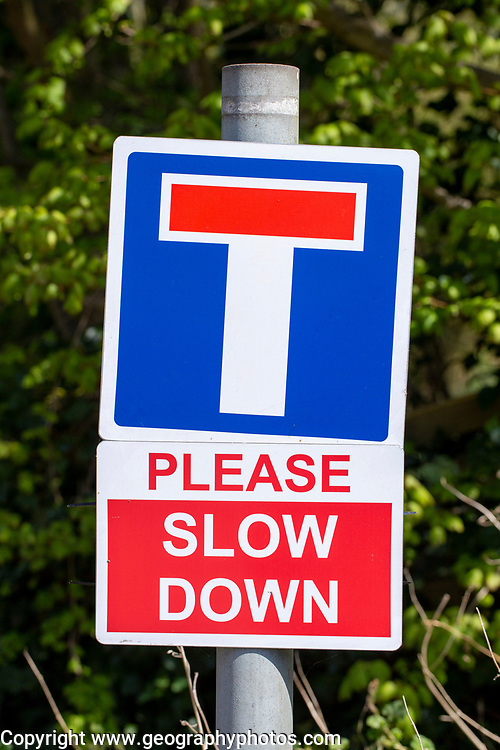 No Through Road Please Slow Down road signs, UK